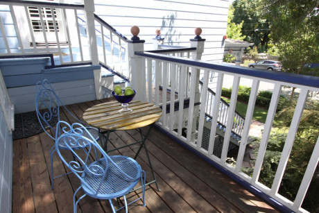 outdoor deck with table and two chairs
