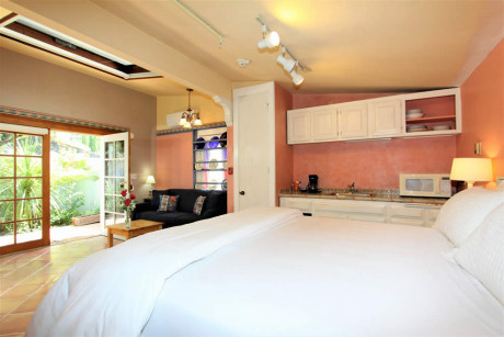 The Napa Inn - room with white bed, lamps, and TV