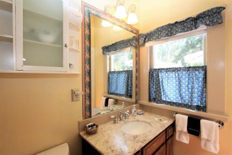 The Napa Inn - bathroom with sink and windows
