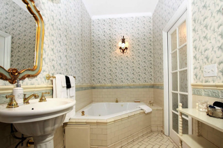 bathroom with sink and spa tub