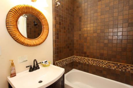 The Napa Inn - bathrrom with sink, mirror and bathtub
